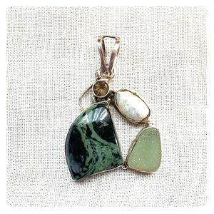 Semi-precious stone and sterling silver pendant.